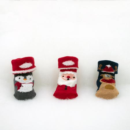 cute baby socks with Christmas motive on white fleece Standard-Bild - 117804143