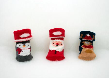 Baby socks with christmas motiveon white fleece Standard-Bild - 117804147