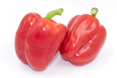 Two tasty red peppers isolated on white Standard-Bild - 127456100