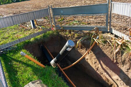 Excavation pit with underground cables. Location: Germany, North Rhine-Westphalia, Borken Stockfoto