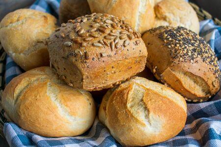 various types of fresh bread rolls in a basket in closeup Standard-Bild - 134139601