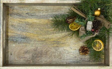 Tray of wood in top view, with Christmas decoration and copy space Standard-Bild - 134193938