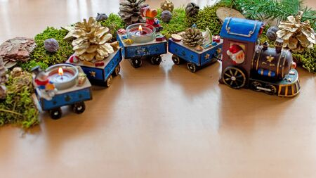 Christmas train with burning candles and christmas decorations Standard-Bild - 135649847