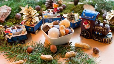 delicious christmas cookies in front of a cute christmas train with burning candles Standard-Bild - 135649848