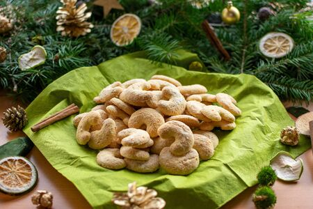 delicious vanilla crescents in front of a arrangement of fir branches Standard-Bild - 135649861