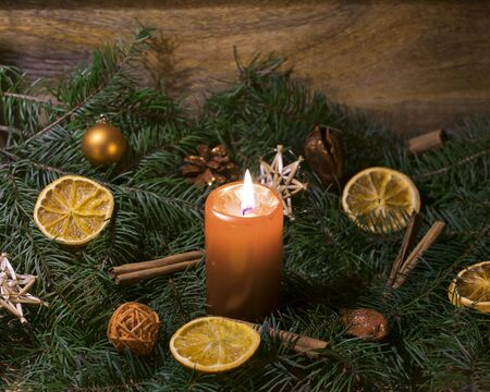 Christmas arrangement with burning candle Standard-Bild - 135649864