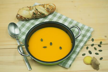 tasty pumpkin seed soup with ginger with pumpkin seed bread