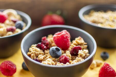 delicious fruit muesli with fresh berries in closeup in sunlight. With blurred background