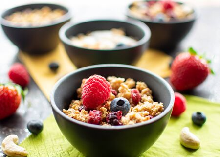 delicious muesli with fresh and dried fruit in a small bowl. With blurred background Standard-Bild