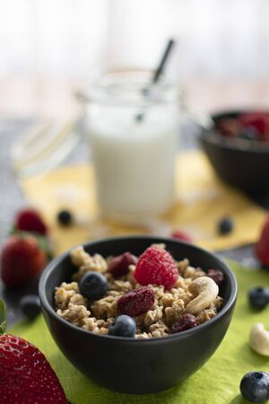 delicious muesli with fresh and dried fruits. With blurred background