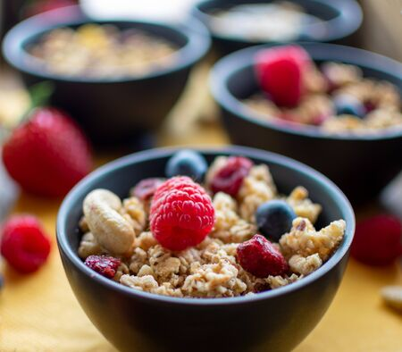 delicious muesli with fresh and dried berries. Close up with blurred, light background