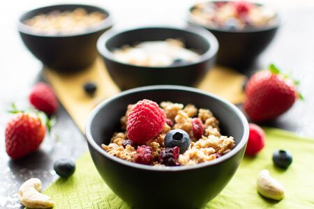 delicious muesli in a small bowl. With blurred, light background