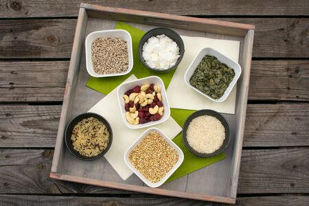 Tray with different types of grains and rice in small bowls on a wooden pallet Reklamní fotografie - 143596029
