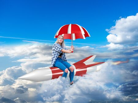 young woman sitting calmly on a rocket with an umbrella in her hand and flying confidently through the clouds