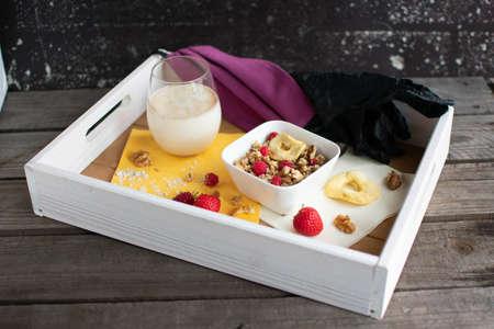breakfast tray with healthy muesli, oat milk, purple face mask and disposable gloves Reklamní fotografie - 150669214