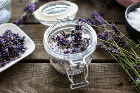 Natural cosmetics: aromatic, lavender bath salt with fresh flowers Reklamní fotografie - 152440916
