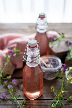 Flowery-scented lavender syrup in preserving bottles filled with lavender sugar.