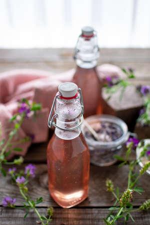 Flowery-scented lavender syrup in preserving bottles filled with lavender sugar. Reklamní fotografie - 152964346