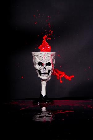 cadaver: blood spouting out of skeleton goblet