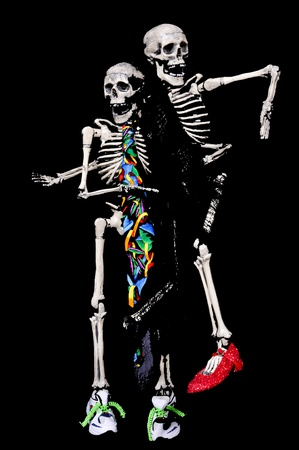 Two Skeletons dancing with their shoes and ties