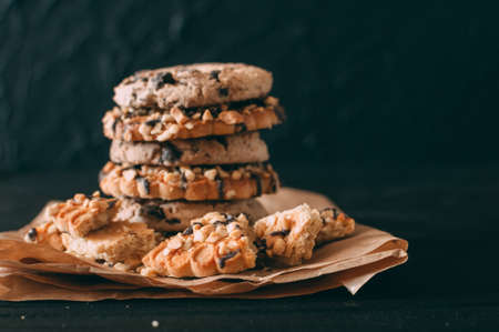 Chocolate chip cookies on dark old wooden table with place for text., freshly baked. Selective Focus with Copy space Foto de archivo