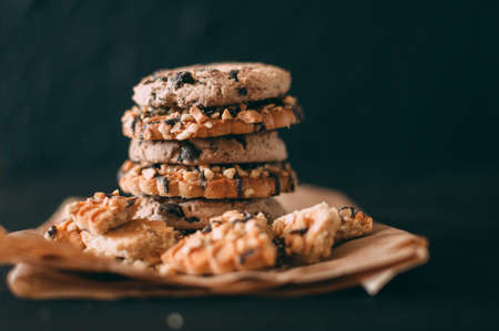 Chocolate chip cookies on dark old wooden table with place for text., freshly baked. Selective Focus with Copy space Stock Photo