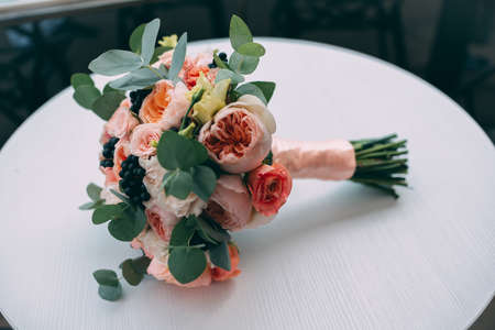 beautiful wedding bouquet of roses on a white table Stok Fotoğraf