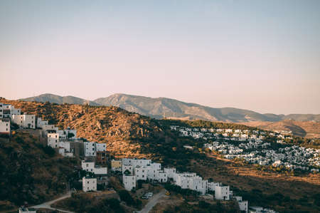 Typical white, cubic Bodrum houses in Turkey with a sea view, during sunset, summer. Stok Fotoğraf - 119946540