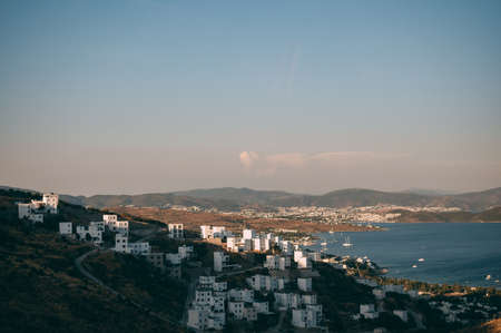 Typical white, cubic Bodrum houses in Turkey with a sea view, during sunset, summer. Stok Fotoğraf