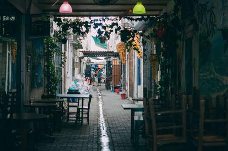 Turkey, Turgutreis, June 10, 2018: A small street near the local bazaar, where 2 local residents argue, a small resort town near Bodrum.