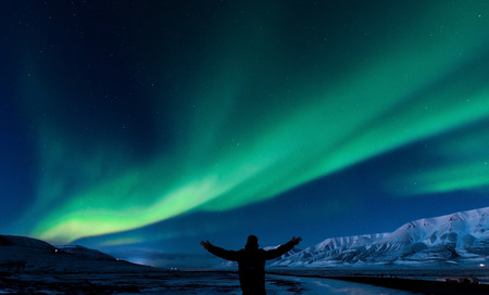 The polar Northern aurora borealis lights in Norway Svalbard in the mountains Фото со стока - 79802951