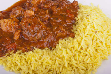 photo of chicken jalfrezi with pilau rice on a plate photo