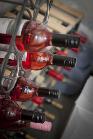stuartkey: photo of wine bottles on a vine rack