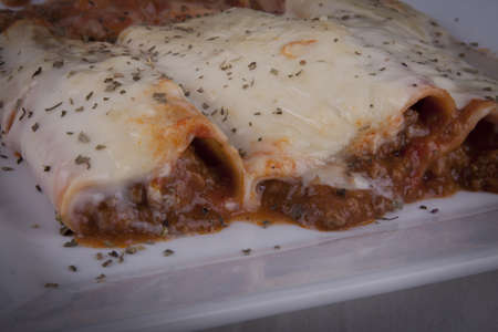 photo of beef cannelloni on a plate photo