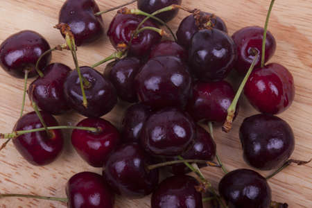 photo of sweet cherries on a wooden board photo