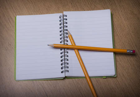 open  notebook on a wooden desk with pencil Stock Photo - 15312269