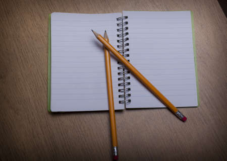 open  notebook on a wooden desk with pencil Stock Photo - 15312263