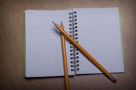 open  notebook on a wooden desk with pencil Stock Photo - 15312266
