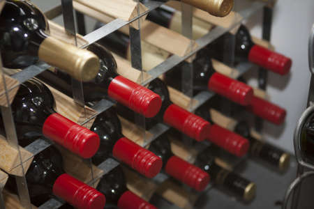 photo of wine bottles on a wine rack Stock Photo