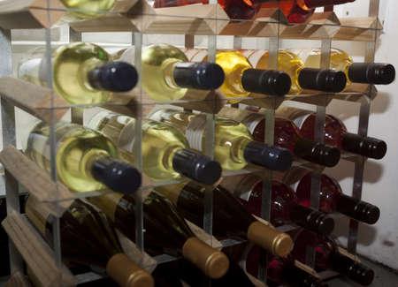 photo of wine bottles on a wine rack photo