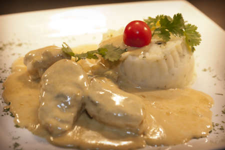 pork medallions with creamy dijon sauce served with mashed potatoes Stock Photo