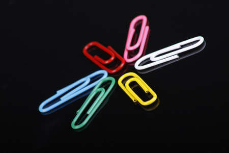 photo of colorfull paper clips on a black background Stock Photo - 16557196