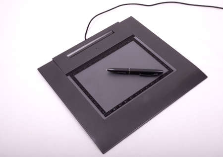 photo of graphic tablet with pen photo