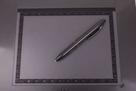 sensitive: photo of graphic tablet with pen