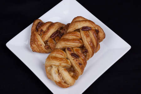 pecan and maple pastries on a plate Stock Photo - 18567612