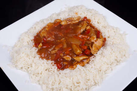 Closeup photo of chinese sweet and sour chicken with rice  Stock Photo - 18568111