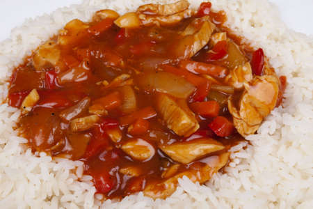 Closeup photo of chinese sweet and sour chicken with rice  photo