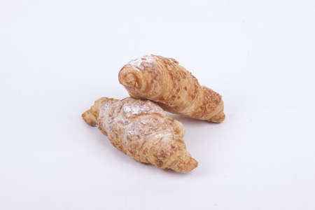 fresh almond croissant isolated on a white  background