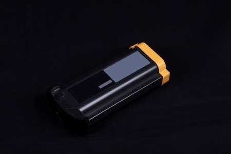 large style digital camera battery  isolated on a black background photo