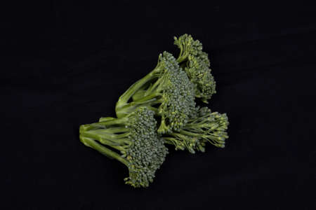 broccoli isolated on black background photo
